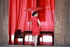 Happy Chinese bride in red cheongsam at traditional wedding day Royalty Free Stock Images