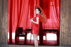 Happy Chinese bride in red cheongsam at traditional wedding day Royalty Free Stock Photo