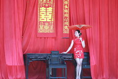 Happy Chinese bride in red cheongsam at traditional wedding day Stock Images