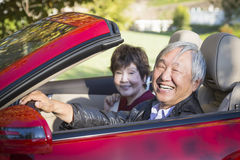 Happy Chinese Couple Enjoying An Afternoon Drive in Their Conver Royalty Free Stock Photography