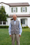 Happy Chinese Elderly Standing in front Yard Royalty Free Stock Photography