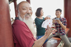 Happy Chinese Family Playing Card In Jing Shan Park, Showing Cards Stock Photos