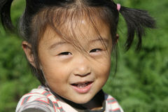 Happy Chinese girl. In autumn time farm period Stock Images