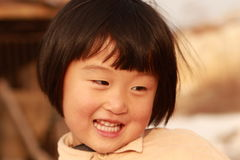 Happy Chinese girl. Happy Chinese little girl in winter time Stock Image