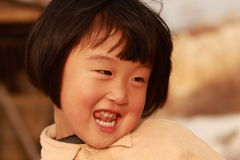 Happy Chinese girl. Happy Chinese little girl in winter time Royalty Free Stock Photos