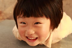 Happy Chinese girl. Happy Chinese little girl in winter time Stock Photo