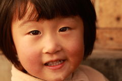 Happy Chinese girl. Happy Chinese little girl in winter time Stock Photos