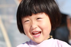 Happy Chinese girl. Happy Chinese little girl in winter time Royalty Free Stock Image