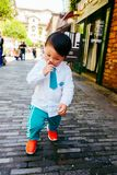 Chinese boy on the street in school uniform. Happy chinese kid join out door activity on the street royalty free stock photos