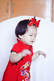 Happy Chinese little baby in red cheongsam have fun Stock Image