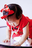 Happy Chinese little baby in red cheongsam have fun Stock Images
