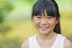 Happy Chinese little girl Stock Photos