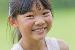 Happy Chinese little girl Stock Images