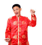 Happy Chinese male in cheongsam hands holding red packets / ang. Pow, isolated on white background Stock Photo