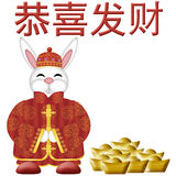 Happy Chinese New Year 2011 Rabbit with Gold Bars. Happy Chinese New Year 2011 Rabbit with Traditional Red Costume Illustration Stock Image