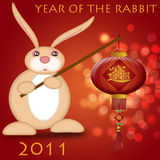 Happy Chinese New Year 2011 Rabbit Holding Lantern. Bokeh Illustration Royalty Free Stock Photo