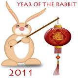 Happy Chinese New Year 2011 Rabbit Holding Lantern. Bokeh Illustration Royalty Free Stock Photography