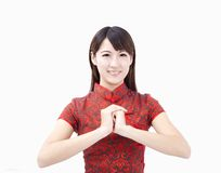 Happy chinese new year. Smiling young woman with gesture of congratulation