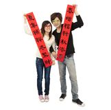 Happy chinese new year. Young couple holding red spring couplets for lucky