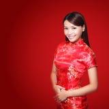 Happy chinese new year. Beautiful young Asian woman dress traditional cheongsam