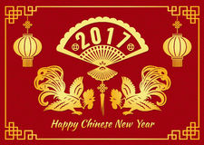 Happy Chinese new year 2017 card is  lanterns rooster chicken and 2017 text in china fans symbols Royalty Free Stock Image