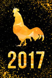 Happy 2017 Chinese New Year card. Vector poster of a golden rooster isolated on black background. Design template for Stock Image
