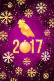 Happy 2017 Chinese New Year card. Vector poster of a golden rooster isolated on violet background. Design template for Royalty Free Stock Photography