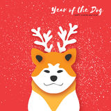 2018 Happy Chinese New Year Greeting Card. Chinese year of the Dog. Paper cut Akita Inu doggy with horns. Snow Stock Images