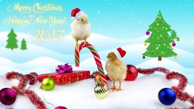 2017 Happy Chinese New Year greeting card with text, two cute small roosters. On winter background with Christmas tree and snowfall stock video