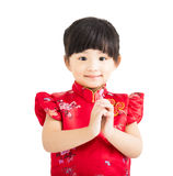 Happy chinese new year.little girl with congratulation gesture Stock Images