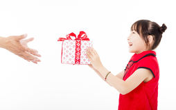 Happy chinese new year.little girl giving gift box Stock Photo