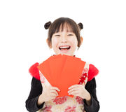 Happy chinese new year.little girl showing red envelope Stock Image