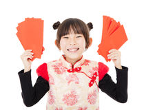 Happy chinese new year.little girl showing red envelope Royalty Free Stock Image