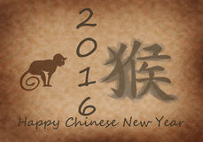 Happy Chinese New Year of the Monkey. Chinese characters and the silhouette of a monkey on the old papyrus. 2016 Royalty Free Stock Photography