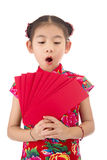 Happy chinese new year. smile asian girl holding red envelope Royalty Free Stock Photo