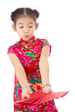Happy chinese new year. smile asian girl holding red envelope Stock Photo