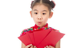 Happy chinese new year. smile asian girl holding red envelope Stock Images