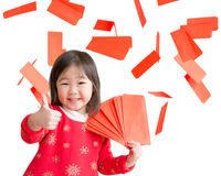 Happy Chinese new year. Smile asian girl show thumb up with red envelope isolated on white background