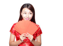 Happy chinese new year. Smiling asian woman holding red envelope