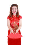 Happy chinese new year. smiling asian woman holding red envelope. Select focus at red envelope Royalty Free Stock Images