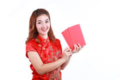 Happy chinese new year. smiling asian woman holding red envelope. On white background Royalty Free Stock Image