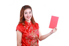 Happy chinese new year. smiling asian woman holding red envelope. On white background Stock Photo