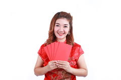 Happy chinese new year. smiling asian woman holding red envelope. On white background Royalty Free Stock Photography