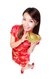 Happy chinese new year. Smiling asian woman showing gold for lucky. chinese mean get rich and happy Stock Image