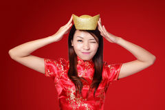 Happy chinese new year. Smiling asian woman showing gold for lucky. chinese mean get rich and happy Royalty Free Stock Photography