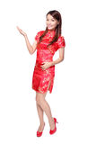 Happy chinese new year. Smiling Chinese woman dress traditional cheongsam and introduce on white background Stock Image