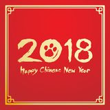 Happy chinese new year 2018 text, Dog footprint ink brush stroke design. In chinese frame gold color isolated on red gradient background with copy space Stock Photography