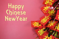 Happy Chinese New Year text greeting with traditional decorations. On red background