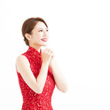 Happy chinese new year, woman with congratulation gesture Stock Photos