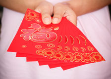 Happy chinese new year, woman hand holding red envelope Stock Photo